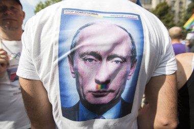 A demonstrator walks down Kurfuerstendamm and protests against Russia's new anti-gay propaganda law with a T-shirt of Russian President Vladimir Putin reading 'Stop Homophobia!' in Berlin, Germany, 31 August 2013. Several thousand people attended the demonstration under the motto 'Enough is Enough - Stop Homophobia', which lead from Kurfurstendamm to the Russian embassy.  EPA/FLORIAN SCHUH