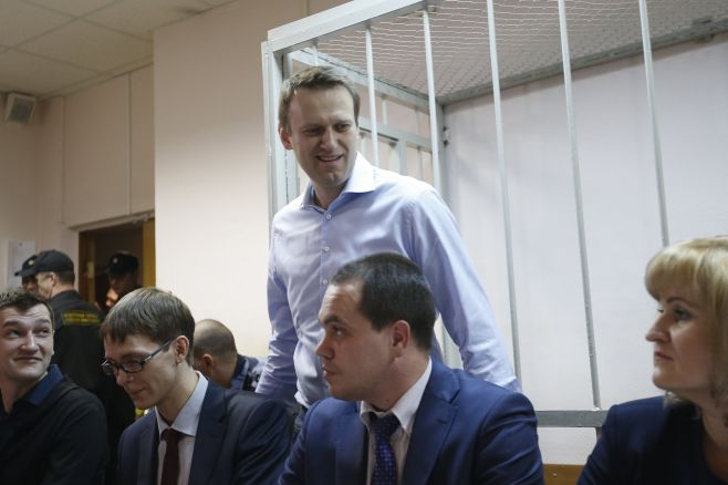 Maxim Zmeyev / Reuters Russian opposition leader and anti-corruption blogger Alexei Navalny arrives at a court hearing in Moscow, Dec. 19, 2014.