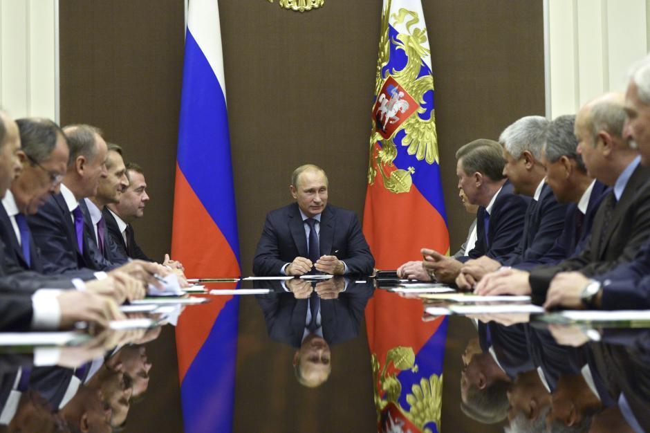 Russia's President Vladimir Putin chairs a meeting of the Security Council. One European expert estimates that at least a third of Russia's diplomats work for Putin's intelligence agencies. Alexei Nikolskyi/RIA Novosti/Kremlin/Reuters