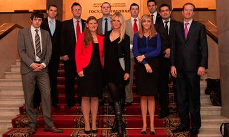 Members of the Conservative Friends of Russia pose on the staircase of Russia's Duma. Richard Royal, the group's executive committee chairman, is back row far right.