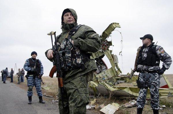 Alexander Ermochenko/epa/Corbis Pro-Russian rebels stand guard at the crash site of Malaysian Airlines jet MH-17 near Donetsk, Ukraine, November 11, 2014