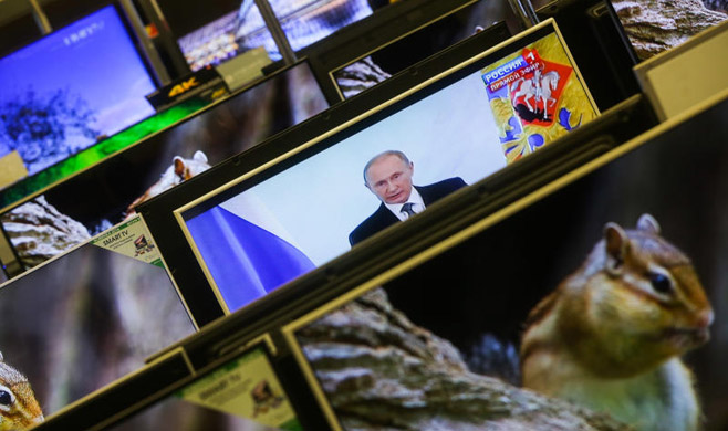 Maxim Stulov / Vedomosti Most of the Russians living abroad rely on Kremlin-backed media for news from home.