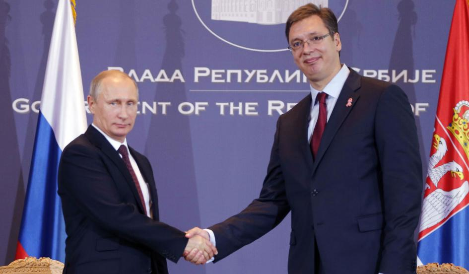 Making Friends: Vladimir Putin shakes hands with Serbian Prime Minister Aleksandar Vucic. Many far left and far right European parties see friendship with Russia as a matter of convenience and applaud Putin's hardline politics. By Marko Djurica/Reuters