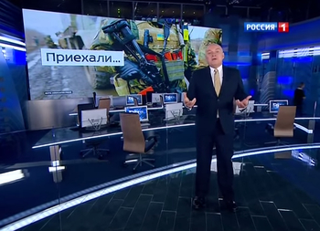 As director of the state-owned Rossiya Segodnya news operation, Dmitry Kiselyev is arguably the face of Russian TV propaganda. He leads the charge against homosexuals, the Ukrainian government, the West, and other perceived enemies of Russia. Image from a video by Vesti Nedeli.