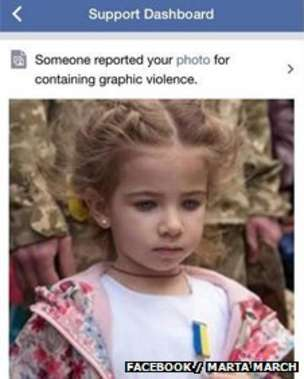 This girl's father was apparently killed fighting Russia-backed separatists in Ukraine. The image was removed after it was reported for containing graphic violence