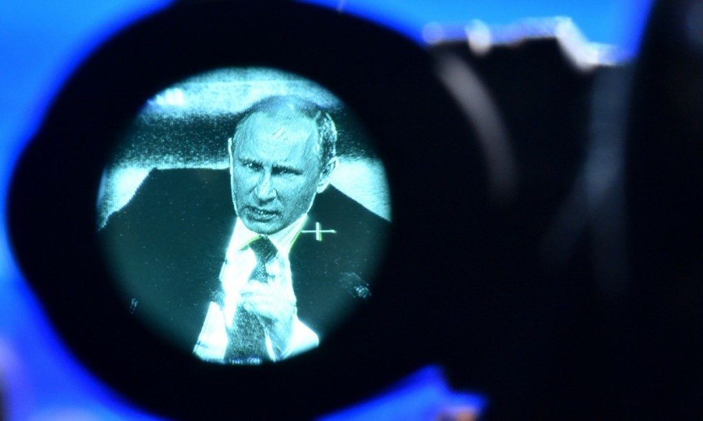Vladimir Putin, seen through a viewfinder, at his annual press conference in Moscow in December 18, 2014. Photograph: Kirill Kudryavtsev/AFP/Getty Images
