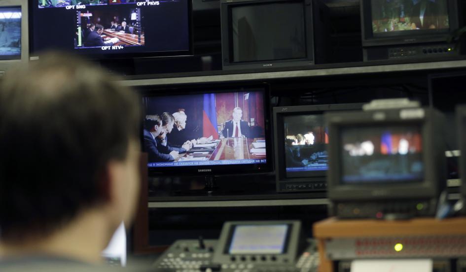 A Pervy Baltiysky Kanal technician supervises the broadcast of Russian TV content in Riga, Latvia, on January 26, 2015. Ints Kalnins/Reuters