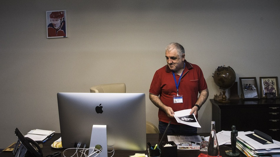 Aram Gabrelyanov, the head of News Media group, which includes LifeNews, looks over his desk inside his Moscow office, June 5, 2015. Image: Evgeny Feldman, Mashable
