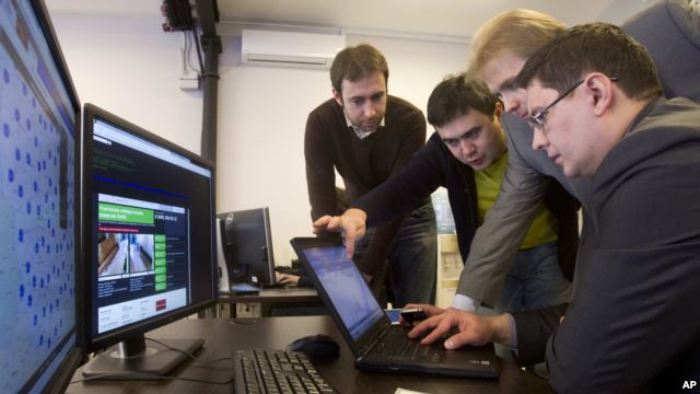 """IT specialists set up a computer system at the """"Elections 2012"""" situation center in Moscow, March 3, 2012."""