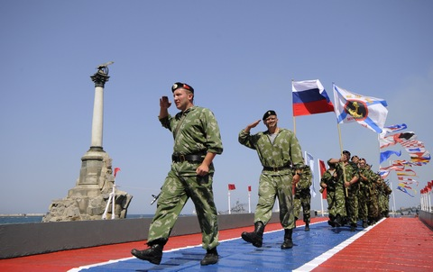 Russian marines march along the embankment of Sevastopol, Crimea, during a celebration of the Navy Day on Sunday, July 26, 2015. (AP Photo/ Alexander Polegenko)