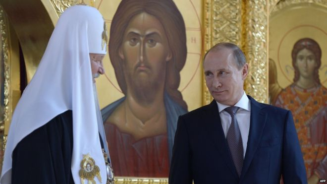 Russian TV viewers are well used to seeing President Putin (right) at Orthodox Church ceremonies