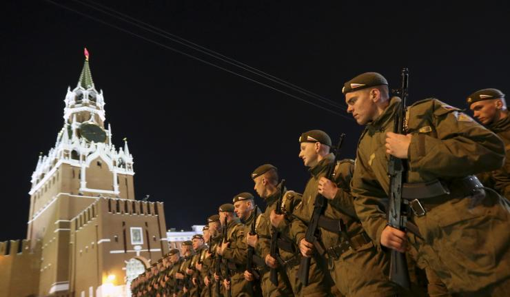 A former Russian internet troll who posted pro-Kremlin propaganda online was awarded one ruble in damages in a labor dispute. In this photo, Russian servicemen march during a rehearsal for the Victory parade, with the Kremlin's Spasskaya (Saviour) Tower seen in the background, on Moscow's Red Square on May 4, 2015. Reuters/Sergei Karpukhin
