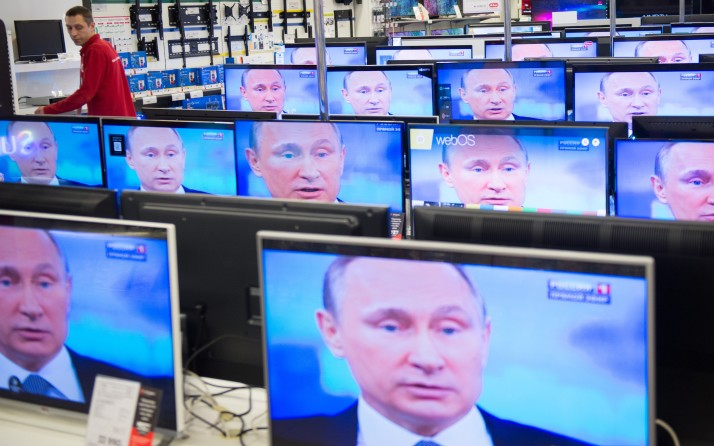An employee stands by TV sets in a shop in Moscow on April 16, 2015 during the broadcast of Russian President Vladimir Putin's annual televised phone-in with the nation. ALEXANDER UTKIN/AFP/Getty Images