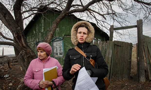 Kutepova (right) stands with a villager in Muslyumovo, one of Russia's most lethal nuclear dumping grounds. Photograph: Denis Sinyakov/Greenpeace/The Moscow Times