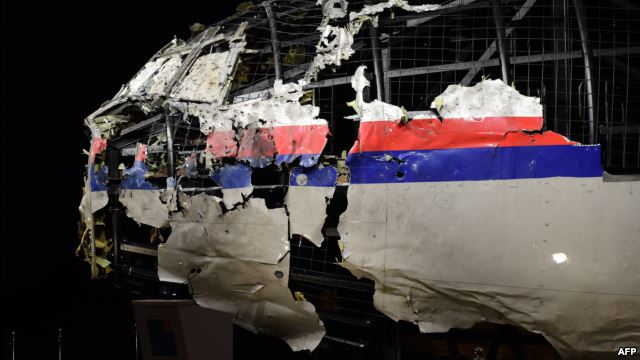 The wrecked, reconstructed cockpit of Malaysia Airlines flight MH17 is exhibited during a presentation of the final report by the Dutch Safety Board on the cause of the crash.