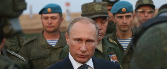 ORENBURG, RUSSIA- SEPTEMBER 19: Russian President Vladimir Putin talks to officers as he is visiting the Center -2015 Military Drills at Donguzsky Range in Orenburg, Russia, September,19,2015. Putin said this week that it's impossible to defeat Islamic State group without support of the government of Syria and that Moscow has provided military assistance to President Bashar al-Assad's regime and will continue to do so. (Photo by Sasha Mordovets/Getty Images)