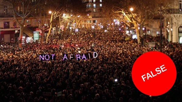 This picture, without the 'False' stamp, was shared widely on Twitter on the night of the recent attacks in Paris but was in fact from January's attack on Charlie Hebdo