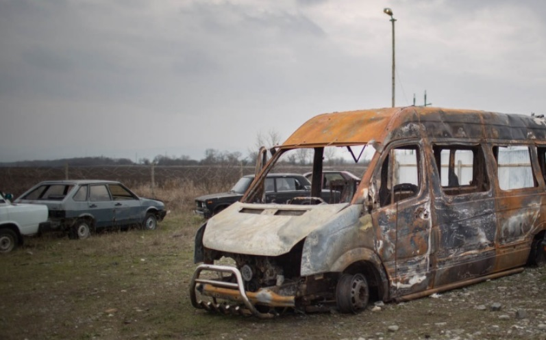 The burn-out frame of a minivan in which journalists and rights activists were traveling near the Chechen border when they were attacked March 9, 2016. Photo by Denis Sinyakov/MediaZone