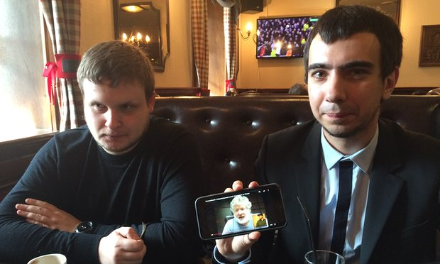 Alexei Stolyarov, left, and Vladimir Kuznetsov in Moscow show video of their prank on Ukrainian oligarch Ihor Kolomoisky. Photograph: The Guardian