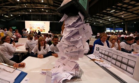 Ballot boxes are opened as counting begins in the Scottish referendum in Aberdeen. Photograph: Scott Heppell/AP