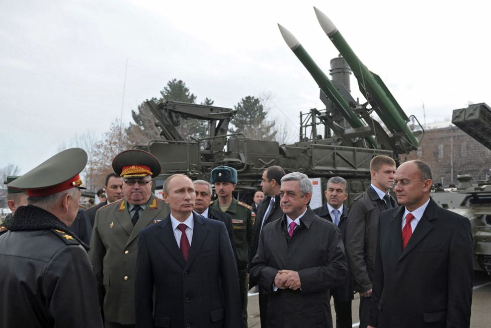 President Putin standing in front of a Buk missile launcher in 2013
