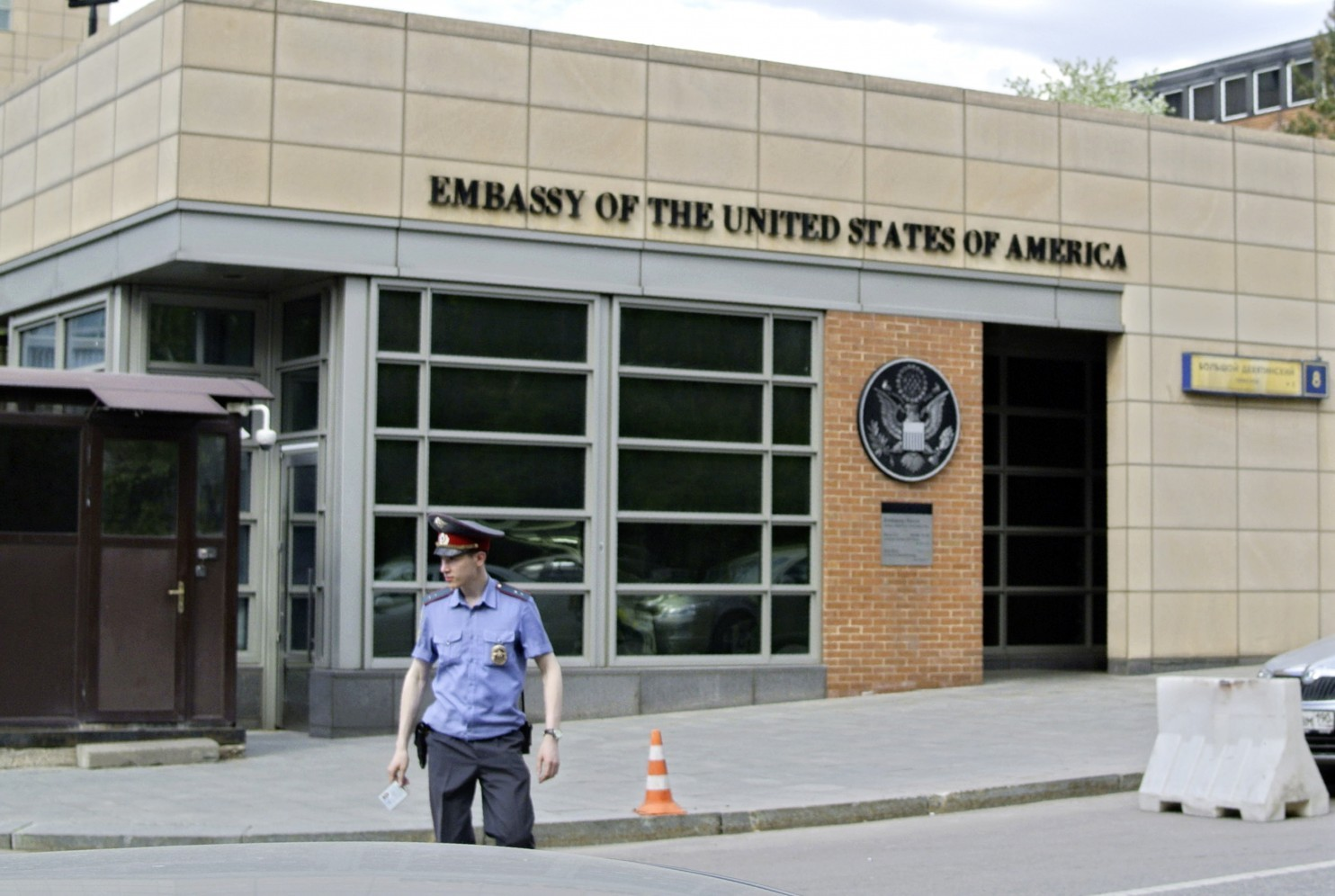 A Russian policeman stands in front of an entrance of the U.S. Embassy in Moscow in 2013. (Ivan Sekretarev/Associated Press)