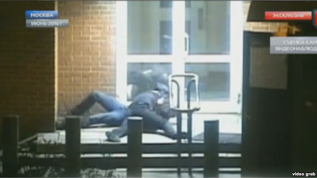 The video, broadcast by Gazprom subsidiary NTV, shows a uniformed man spring from a guard station and tackle the diplomat after the latter exits a taxi and heads toward the embassy door