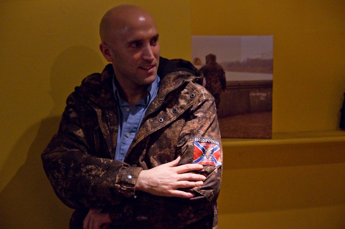 Phillips posing for a photo wearing a pro-separatist jacket at what he calls a charity event for militant-held territories (GettyImages Photo)