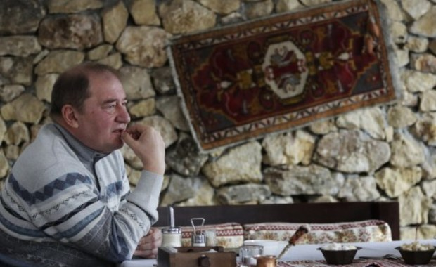 A picture taken on February 12, 2015 shows Mejlis member Ilmi Umerov, former head of the Bakhchysaray's district, looking on during an interview with AFP in Bakhchysaray. (AFP) Photo by AFP