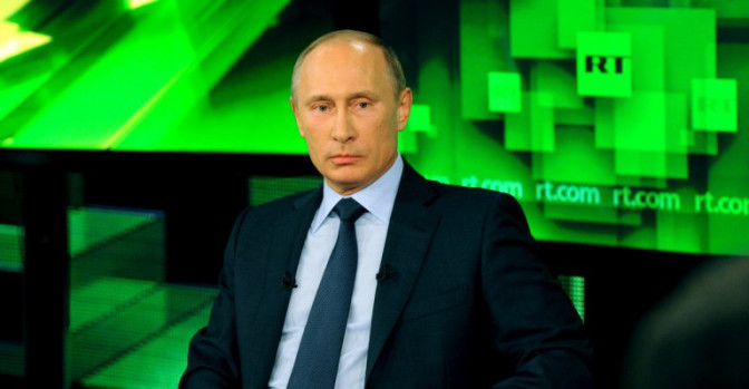 "Vladimir Putin giving an interview to Russian propaganda TV channel ""RT,"" formerly known as ""Russia Today"" (image: screen capture)"