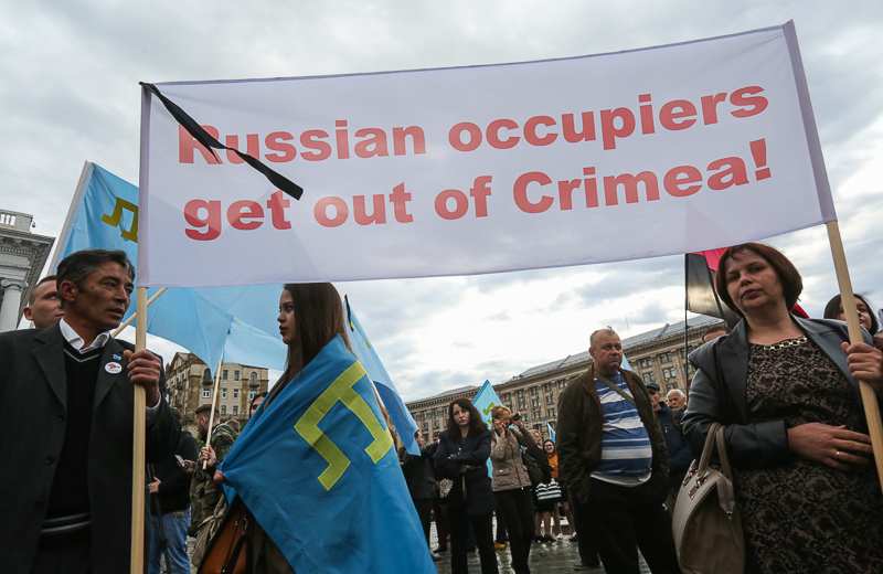 People hold a poster as they attend a rally to commemorate 72 years since Crimean Tatar deportation on Maidan Nezalezhnosti in Kyiv on May 18. (Volodymyr Petrov)