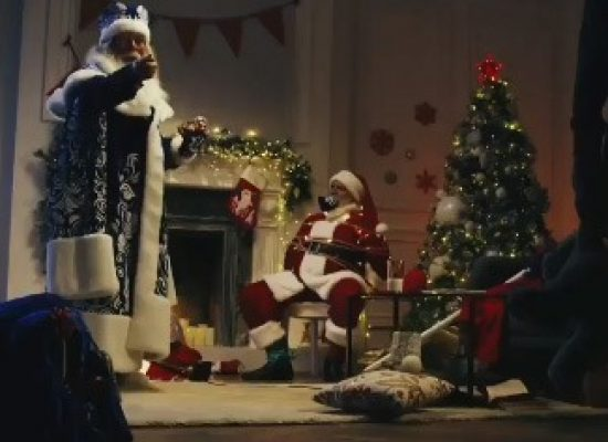 Russia Today video has Father Frost tying up Santa Claus, forcing US сhild to recite poetry